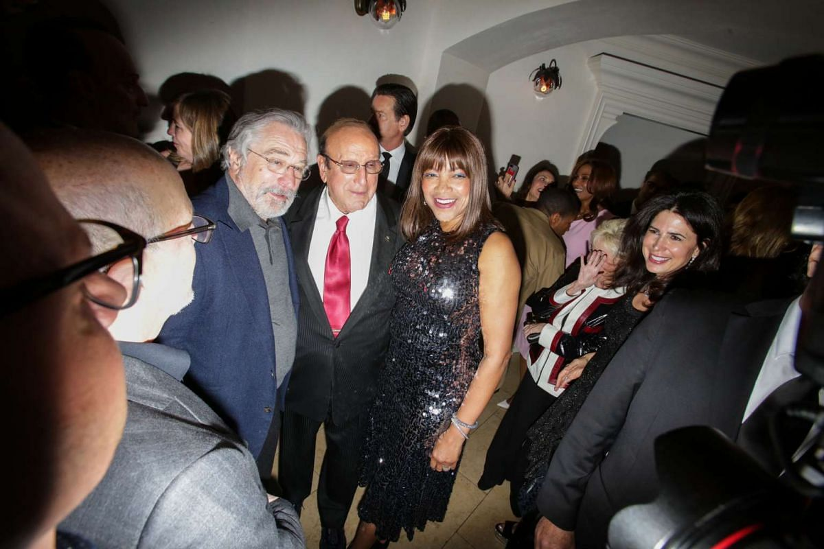 Music producer Clive Davis, flanked by Robert De Niro, a founder of the film festival, and Grace Hightower, at the after party for the opening night of the Tribeca Film Festival at Tavern in New York, on April 19.