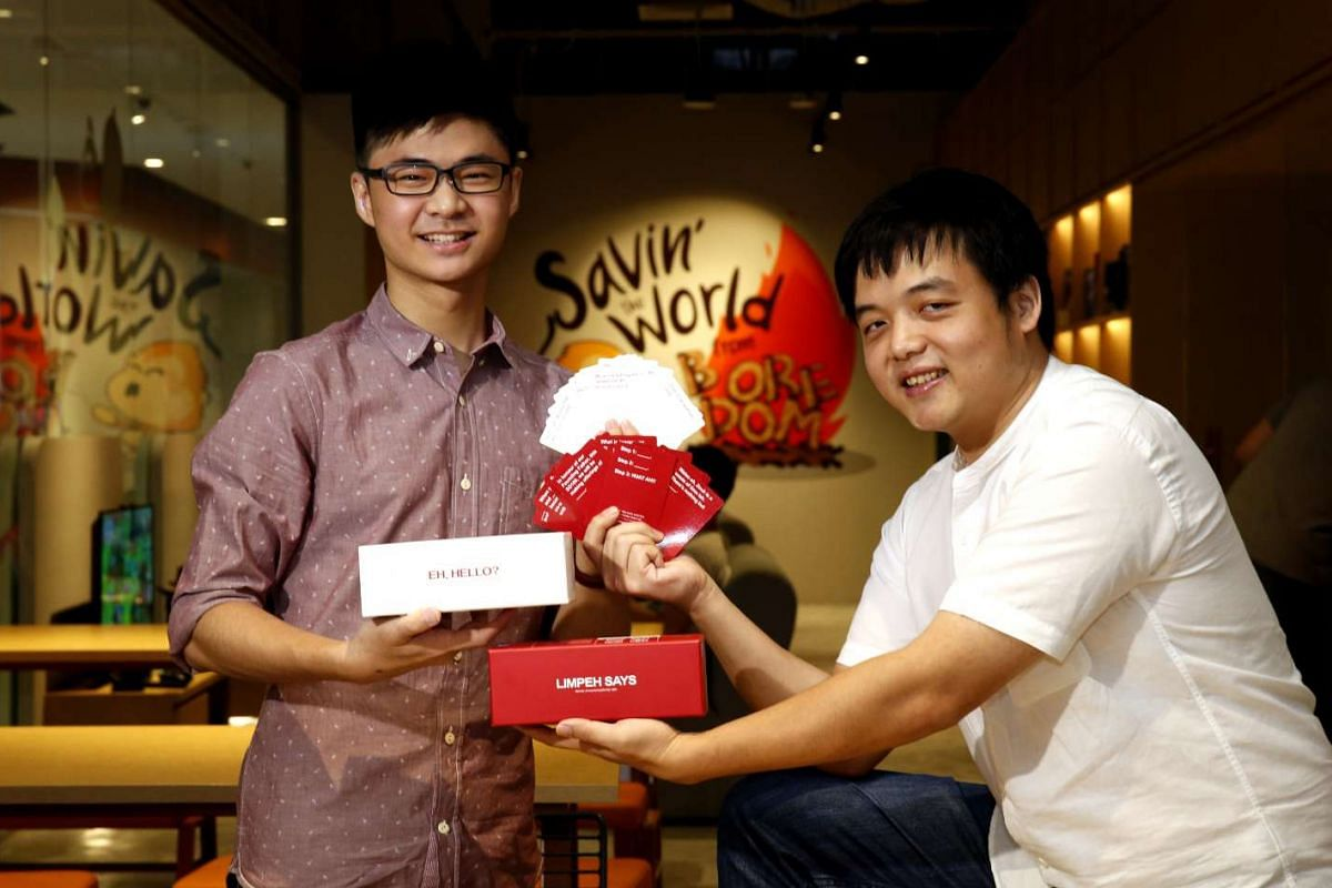 Created by student Tan Yong Heng (left) and games cafe founder Gabriel Leow, Limpeh Says lets players create funny statements with its cards.