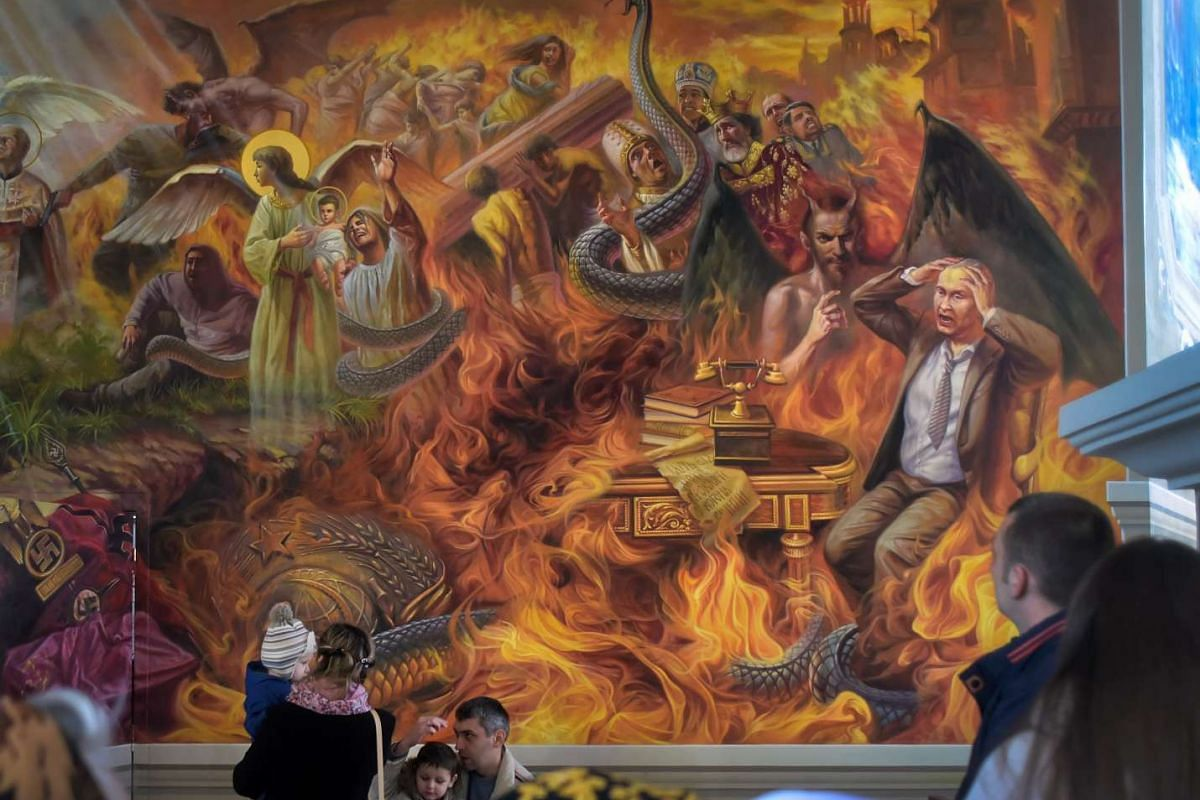 Visitors walk by a fresco depicting the Doomsday scene with a figure resembling the Russian President Vladimir Putin burning in hell together with former Soviet Union and German Nazi symbols at the St. Josaphat Church in Chervonograd city, Ukraine, A