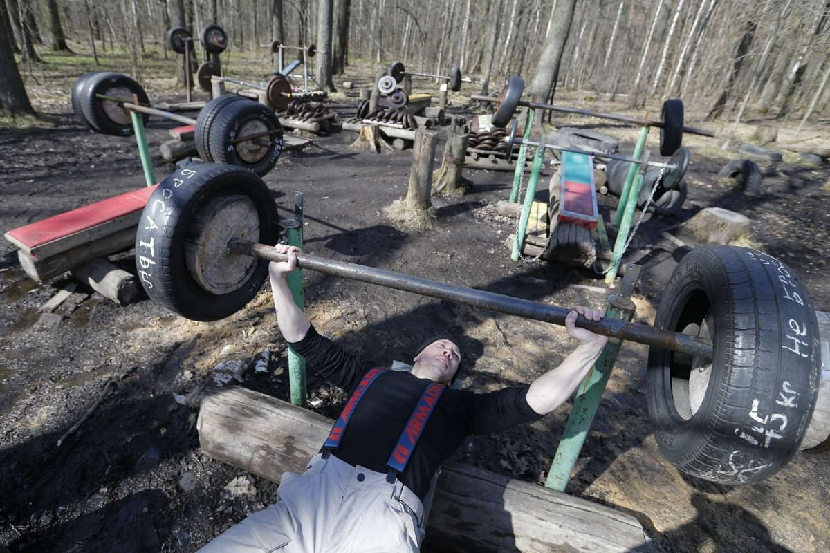 A Russian man exercises in a local resident built outdoor gym in Timiryazevsky Park, Moscow, Russia April 23, 2017. The outdoor gym exists since 2012. Local residents continue to improve their hand made training apparatus from wood and old spare part
