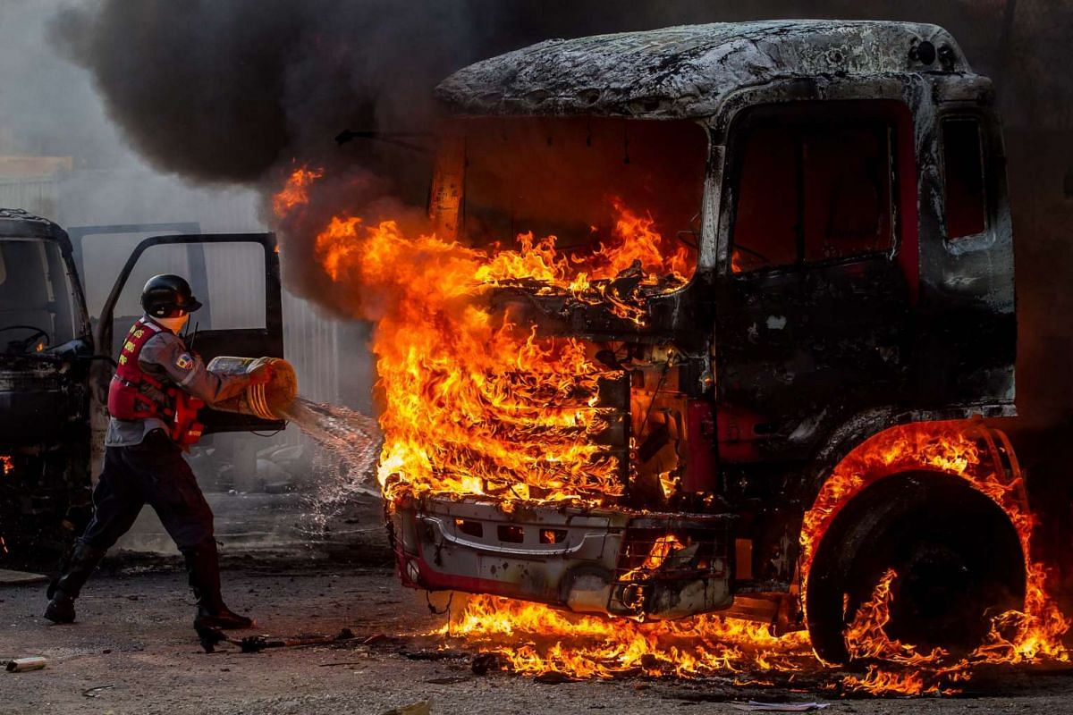 Emergency personnel try to extinguish a burning truck during a demonstration against the Venezuelan government in Caracas, Venezuela, April 24, 2017. PHOTO: EPA