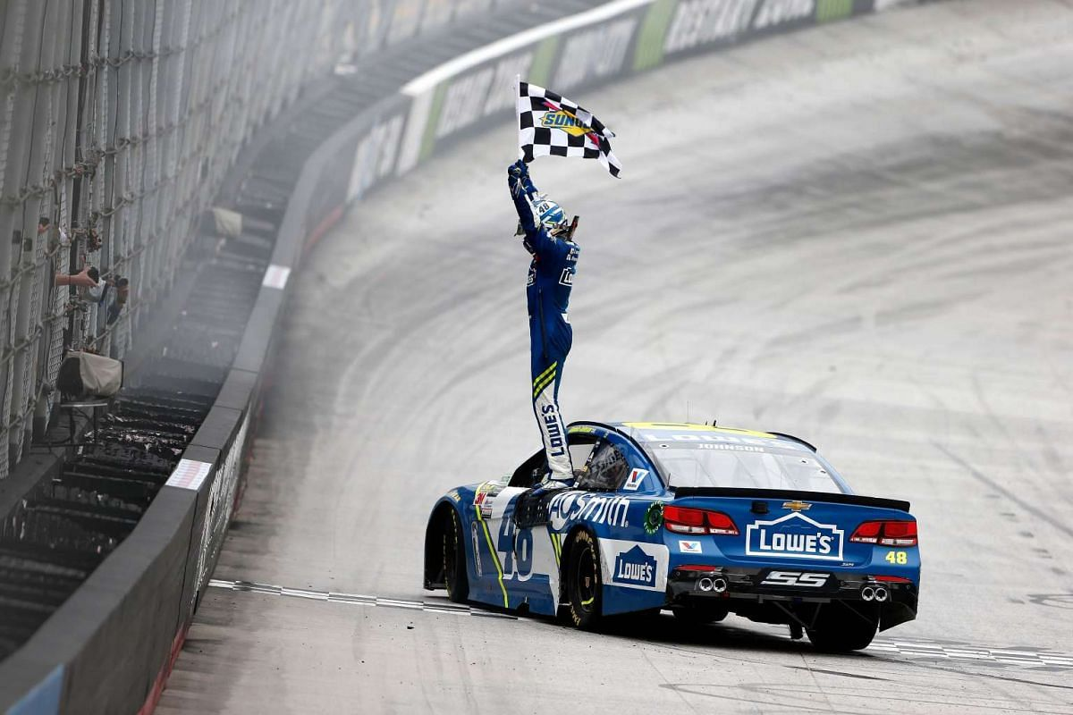 Jimmie Johnson, driver of the #48 Lowe's Chevrolet, celebrates with the checkered flag after winning the Monster Energy NASCAR Cup Series Food City 500 at Bristol Motor Speedway on April 24, 2017 in Bristol, Tennessee. PHOTO: GETTY IMAGES/AFP