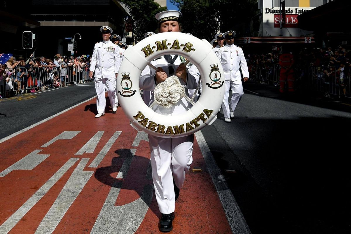 Defense forces veterans and active servicemen and women take part in an Anzac Day march through central Brisbane, Queensland, Australia, on April 25, 2017.