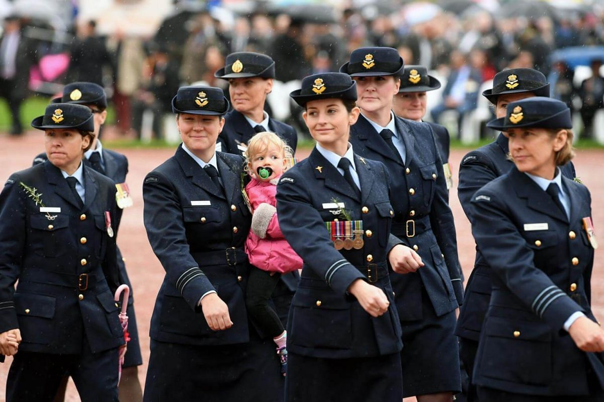 Female members of the Australian Air Force participate in the Anzac Day march at the Australian War Memorial in Canberra, Australian Capital Territory, Australia, on April 25, 2017.