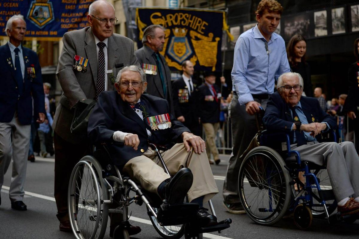 War veterans and their family members march in the Anzac Day parade in Sydney on April 25, 2017.