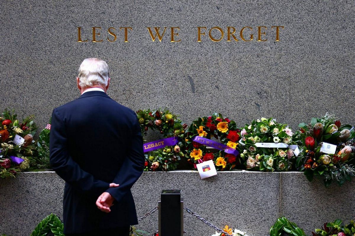 A veteran looks at floral tributes and wreaths that have been laid at the Cenotaph before the start of the annual Anzac Day march through central Sydney, Australia, on April 25, 2017.