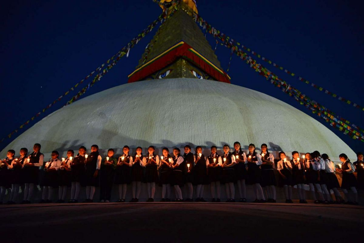Nepalese school children take part in a candle lighting memorial for the victims of the April 25, 2015 earthquake in Kathmandu on April 25, 2017, as the country marks two year anniversary a deadly earthquake struck the Himalayan nation. PHOTO: AFP