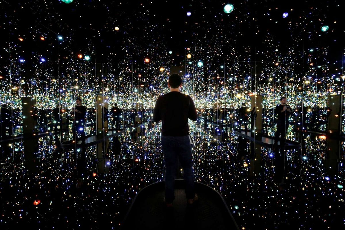 "A man views the exhibit ""Infinity Mirrored Room - The Souls of a Million Light Years Away"" by Japanese artist Yayoi Kusama at the Hirshhorn Museum in Washington, U.S., April 25, 2017. PHOTO: REUTERS"
