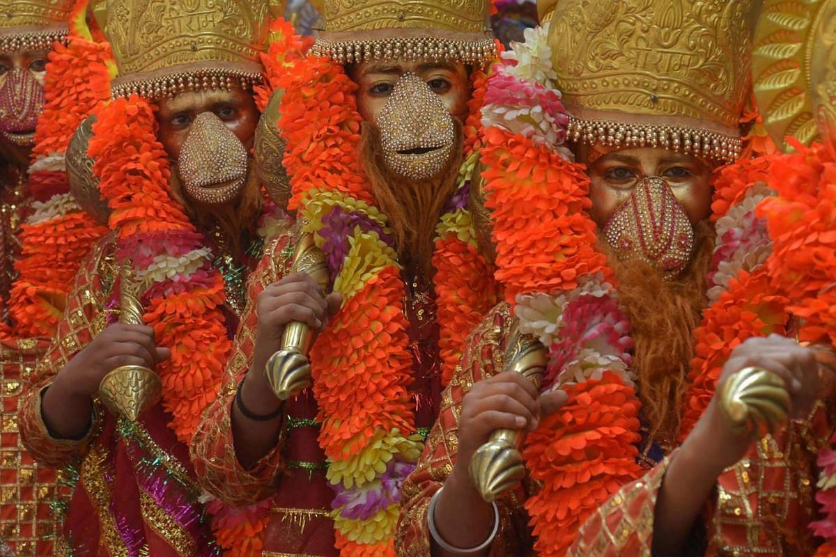 Indian devotees dressed as Hindu God Hanuman participating in a religious procession ahead of the Holi festival in Amritsar. 