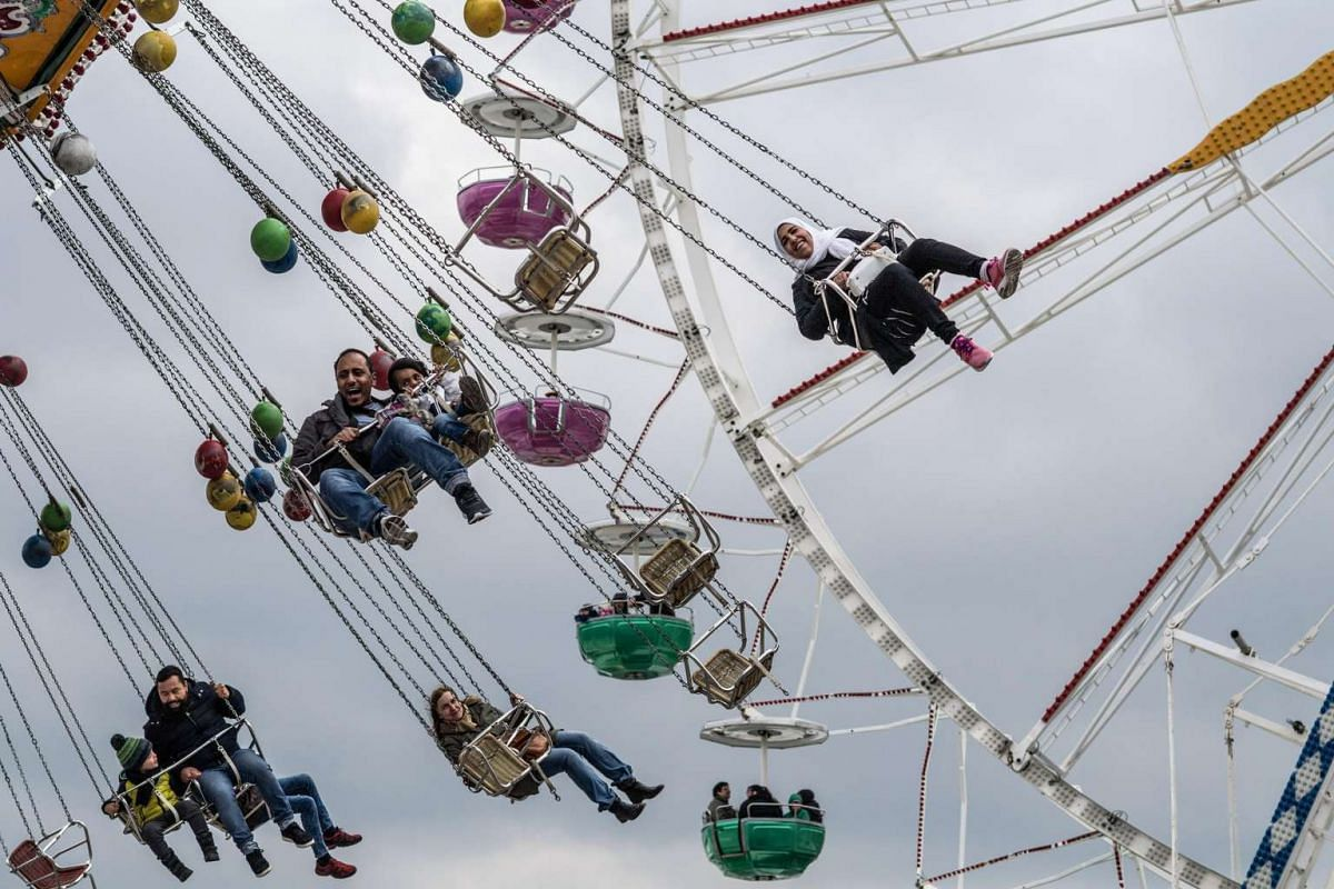 People ride a carousel at the Spring Festival on the Theresienwiese in Munich, Germany, on April 23. The 53rd Spring Festival, which is also known as the little sister of the Oktoberfest Beer Festival, takes place until  May 7.