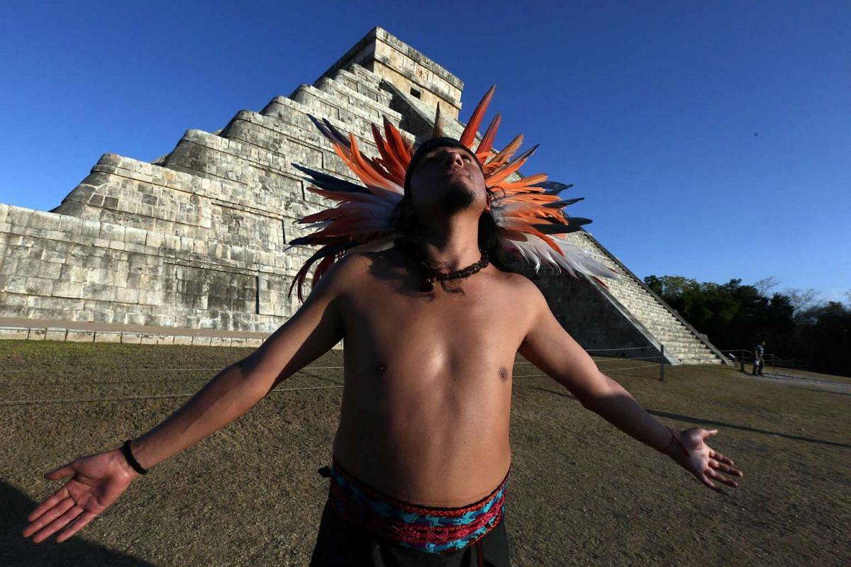 A man wearing a pre-Hispanic costume is backdropped by the Kukulcan Pyramid at the Chichen Itza archaeological site in Yucatan State, Mexico, during the celebration of the spring equinox on March 20.