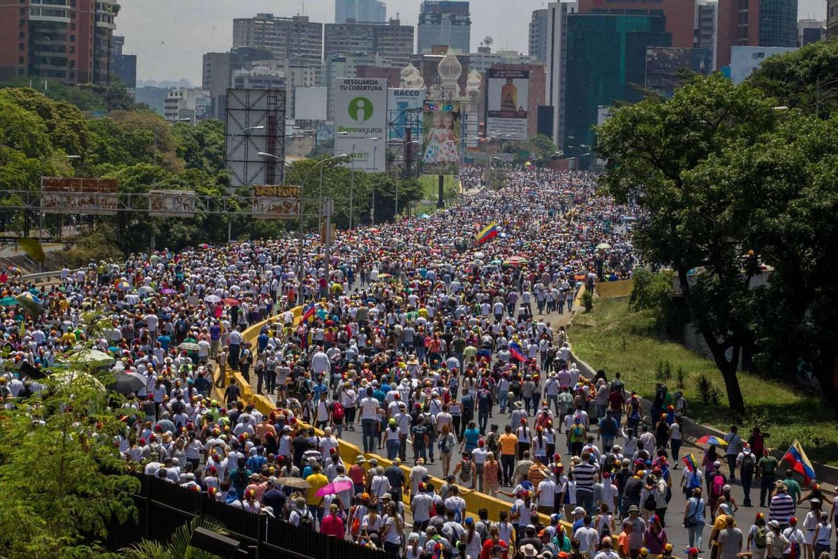 Thousands of Venezuelans   taking to the streets in a nearly month-long protest against the government of President   Maduro.