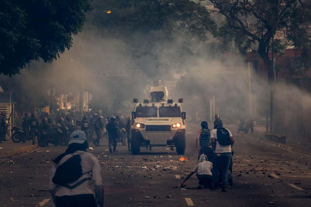 Police, using tear gas, dispersed protesters in the centre of Caracas on April 19. Venezuela has been  the scene of massive protests for both government supporters and opposition groups, heightening tension throughout the country.