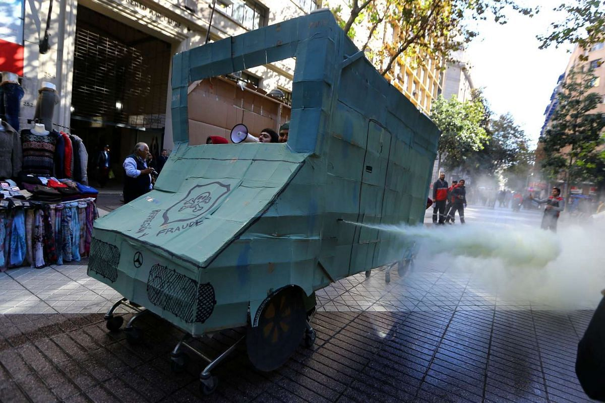 Demonstrators use a fake riot police vehicle as students strike to request changes in the education system and against a million-dollar money fraud within the Chilean police, in Santiago, Chile April 27, 2017. PHOTO: REUTERS