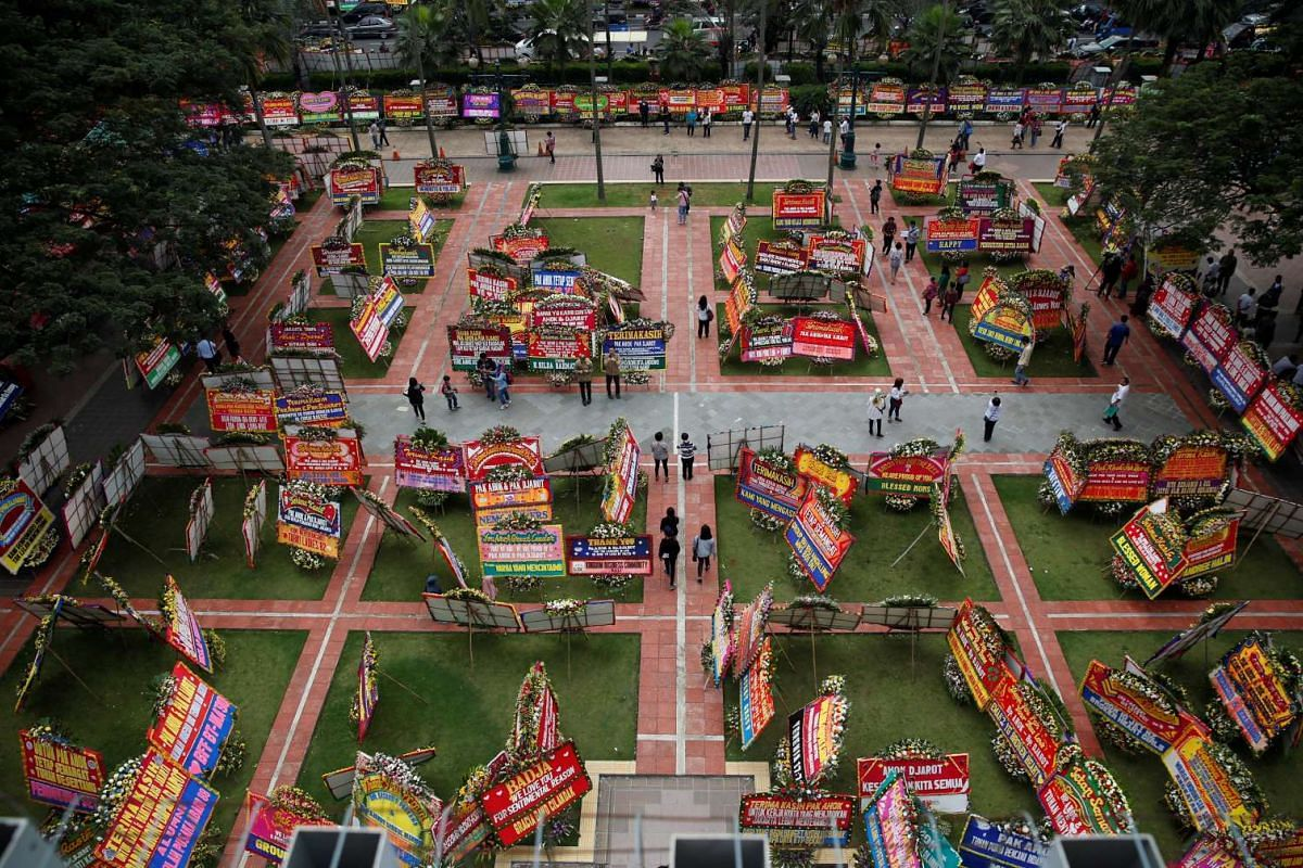 """Flower boards, sent by supporters of outgoing Jakart governor Basuki """"Ahok"""" Tjahaja Purnama, who lost lasts week's gubernatorial election, are seen on the lawn of city hall, in Jakarta, Indonesia April 27, 2017. PHOTO: REUTERS"""