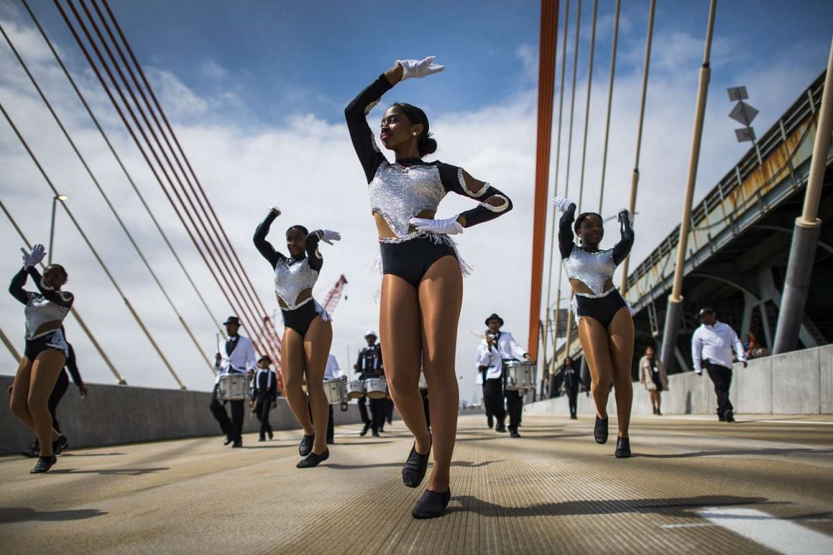 Members of the Brooklyn United Marching Band during grand opening events for a new cable-stayed span that is replacing the rusting Kosciuszko Bridge, visible on the right, in New York, April 27, 2017. PHOTO: THE NEW YORK TIMES