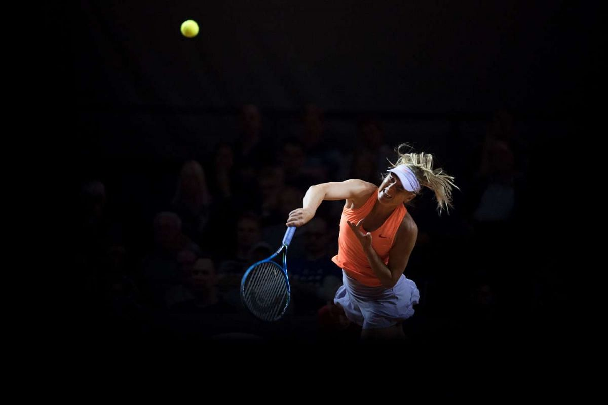 Russia's Maria Sharapova serves to Russia's Ekaterina Makarova in their second round match at the WTA Porsche Tennis Grand Prix in Stuttgart, southwestern Germany, on April 27, 2017. PHOTO: AFP