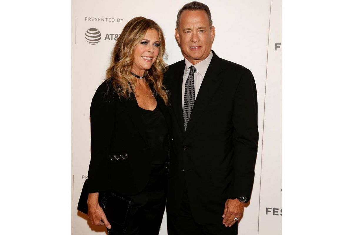 Actor Tom Hanks (right) and his wife Rita Wilson arrive for The Circle premiere.