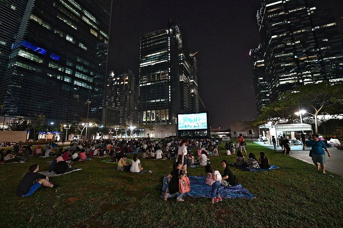 The movie screenings by Be My Kaki Movie Bus seek to recreate the kampung experience of communal movie watching. At MovieMob screenings, moviegoers can sit on mats provided by the organisers and have a picnic.