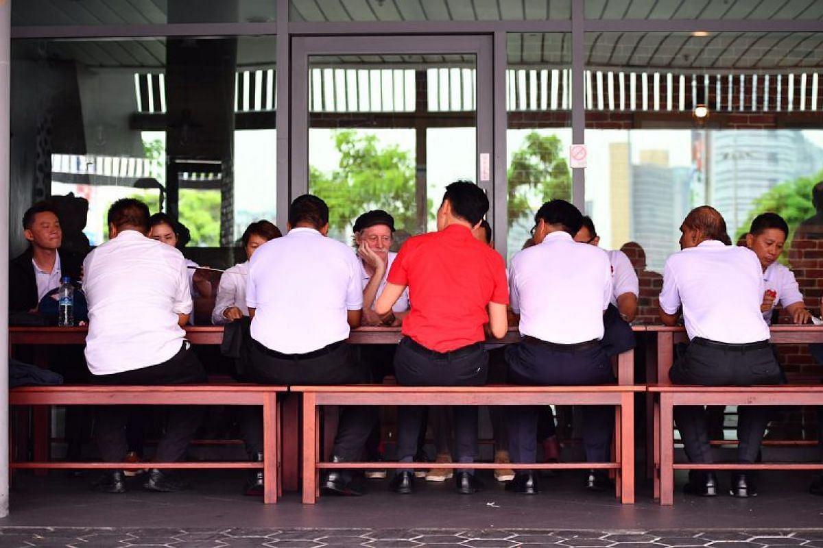 Team Game Changers, with Bill Ng (in red), having lunch at Kallang Wave Mall.