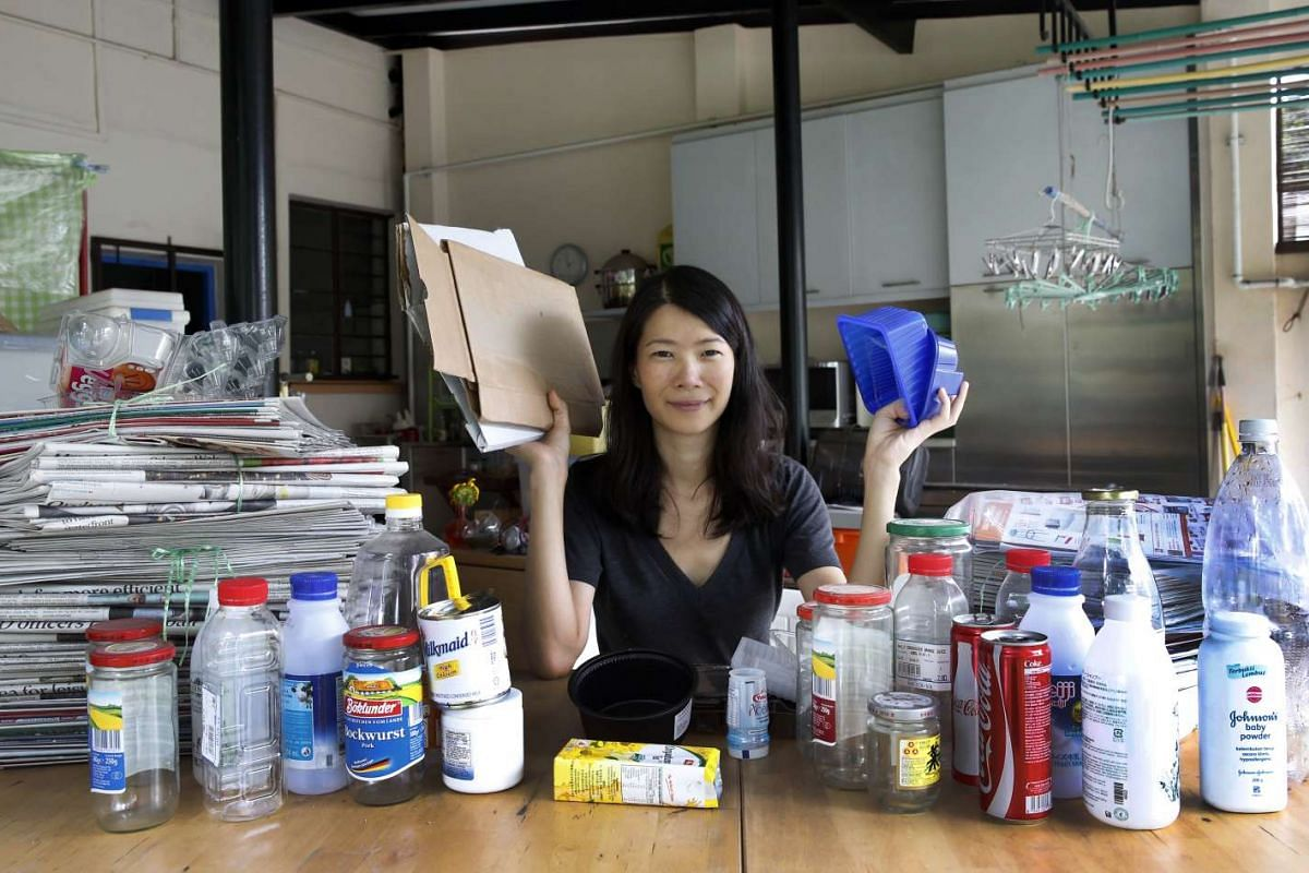 The items freelance writer Olivia Choong collects in her home for recycling include used newspapers, milk cans and plastic containers.
