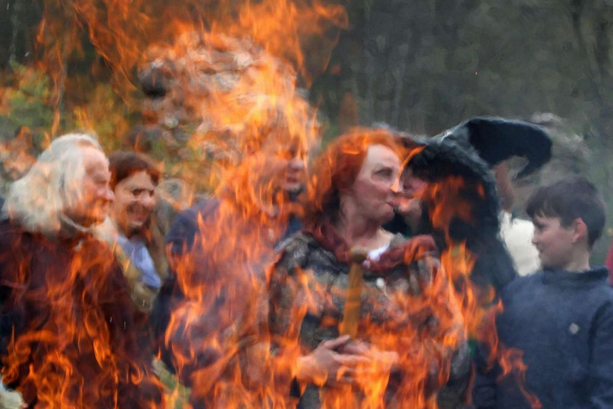 People perform witch craft rituals as they celebrates the so-called Walpurgis Night or Witches' Night in Vilnius, on May 1, 2017.