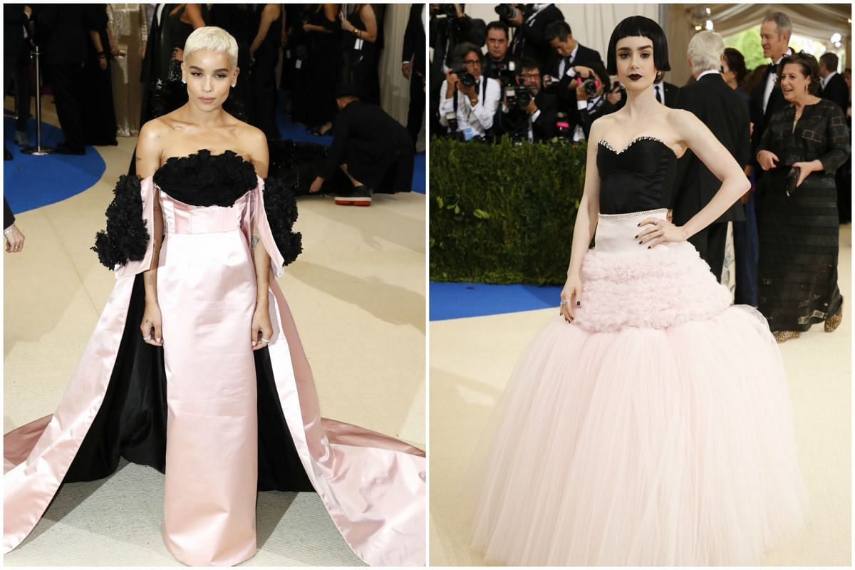 Actresses Zoe Kravitz (left) and Lilly Collins do pretty in pink and black at the event.