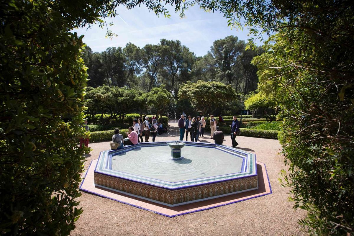 Guests milling around the garden's fountain. PHOTO: AFP