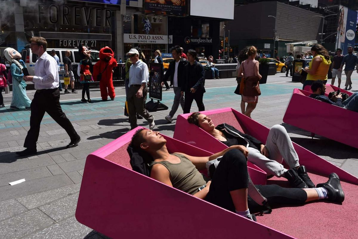People try out the Times Square Pedestrian Mall lounges in Times Square on May 2, 2017, in New York.