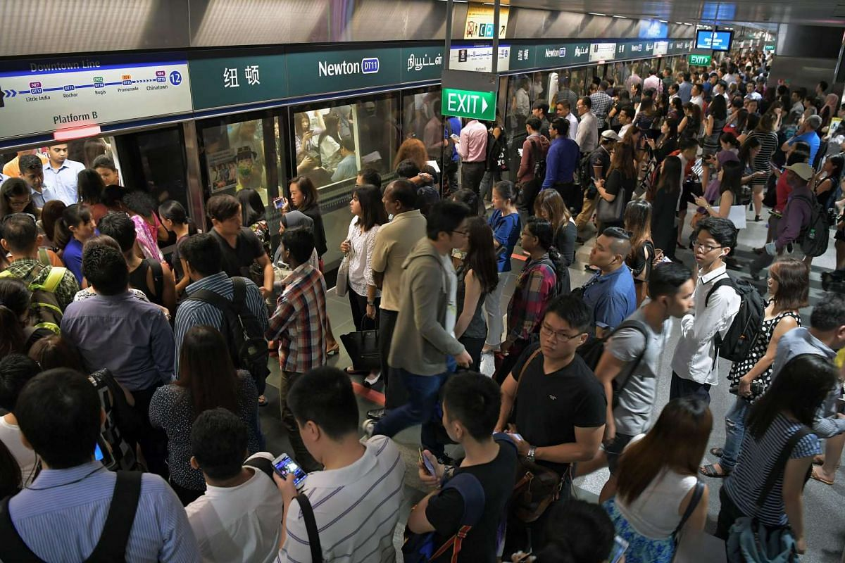Commuters during the morning peak hour at Newton MRT station along the Downtown line on May 3, 2017. Train services on the Downtown Line between Bukit Panjang and Chinatown stations were delayed during the morning peak hour on Wednesday due to a sign