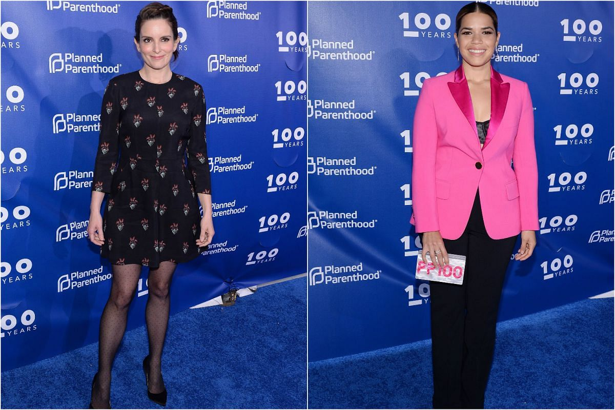 Comedienne Tina Fey (left) turned up in a short black dress while actress America Ferrera brightens up the mood with a pink pantsuit.