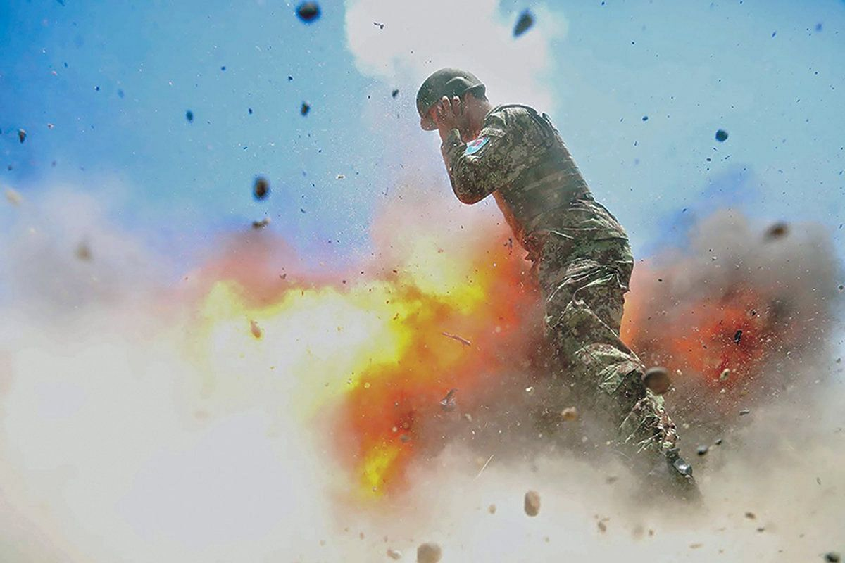 A mortar tube accidentally explodes, killing four Afghan soldiers and U.S. Army photographer who took the photo, Spc. Hilda I. Clayton, during an Afghan National Army (ANA) live-fire training exercise in Laghman Province, Afghanistan July 2, 2013. Th