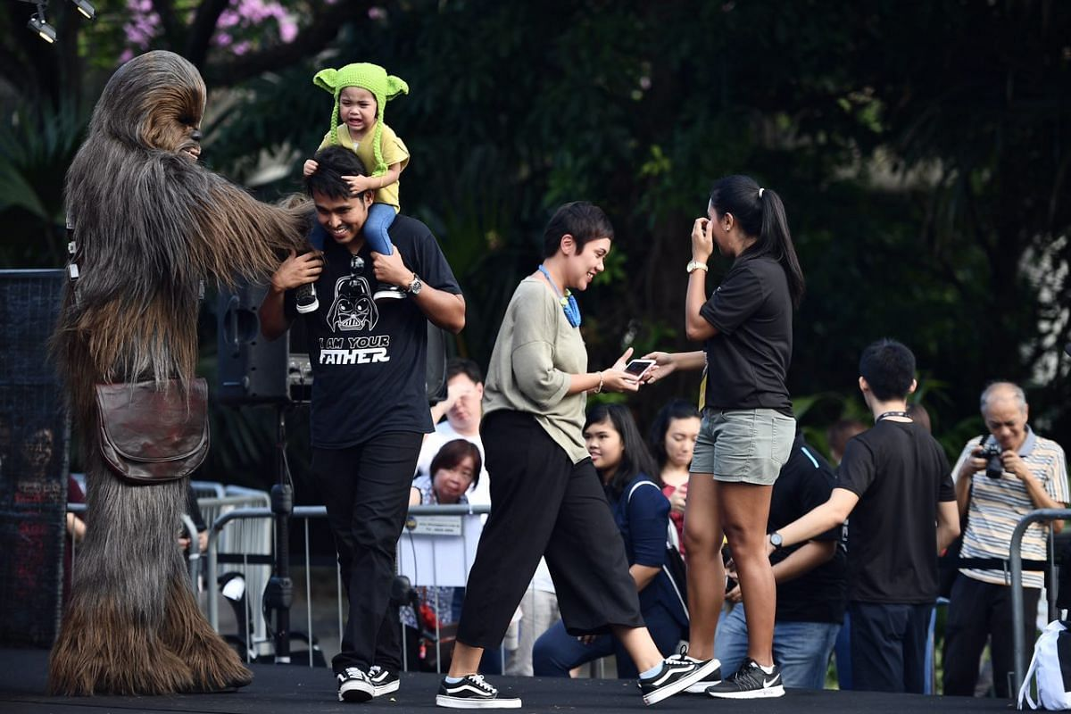 Fans take photos with Chewbacca at the Supertree Grove.