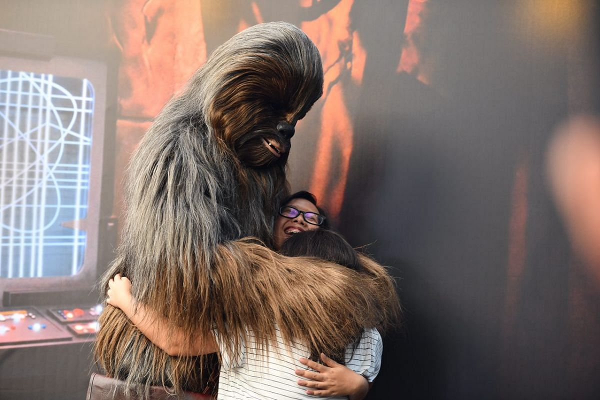 Chewbacca hugging fans on stage at the Supertree Grove.