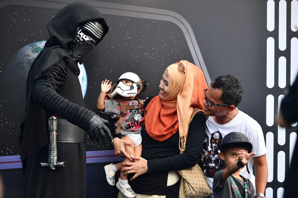 Film director Faisal Ishak, his script writer wife Umie Isa, his son Ayden Farish and daughter Leia Safiyyah taking a photo with Kylo Ren.