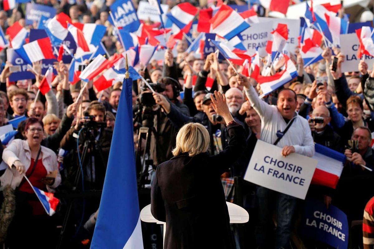 """Marine Le Pen, French National Front (FN) candidate for 2017 presidential election, attends a """"people's party"""" with supporters in Ennemain, northern France, May 4, 2017."""