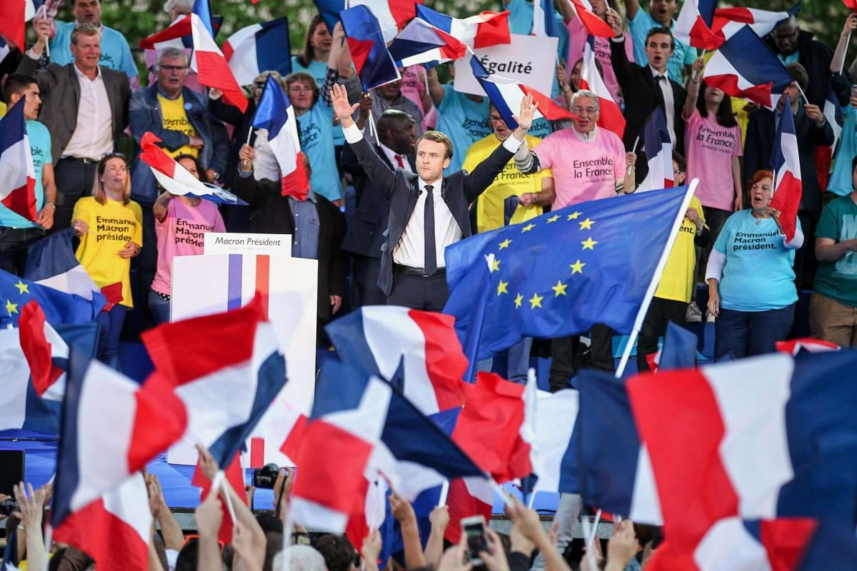 French presidential election candidate for the 'En Marche!' (Onwards!) political movement, Emmanuel Macron (C), is cheered as he delivers a speech during an election campaign rally in Albi, France, May 5, 2017. France will hold the second round of th