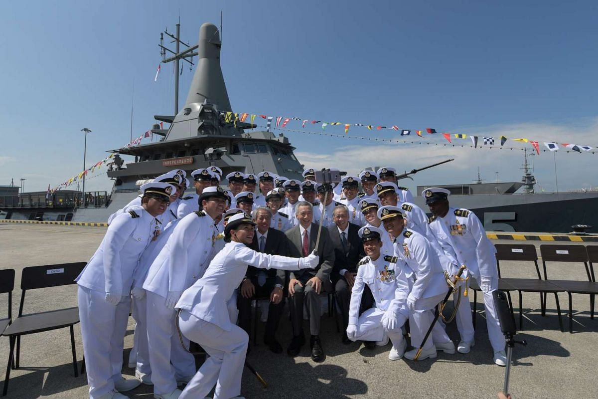 Prime Minister Lee taking a photograph with the crew of the RSS Independence at the Republic of Singapore Navy's Navy Day celebrations on May 5, 2017