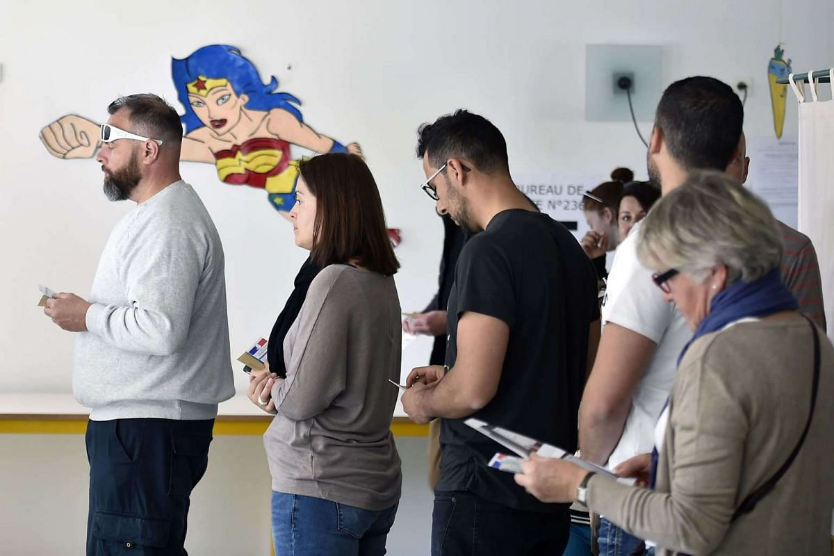 People queueing up to vote at a polling station in Toulouse on May 7, 2017.