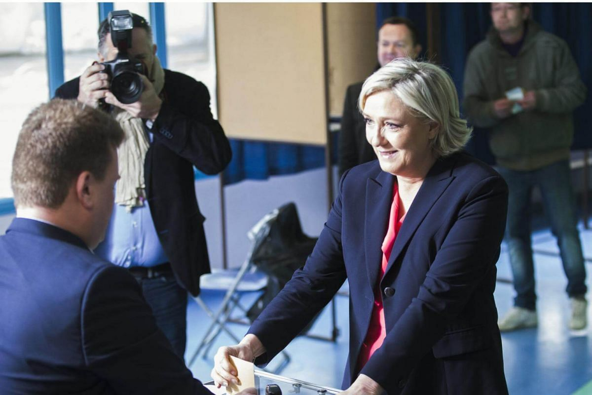 French presidential candidate Marine Le Pen voting at a polling station in Henin-Beaumont, on May 7, 2017.