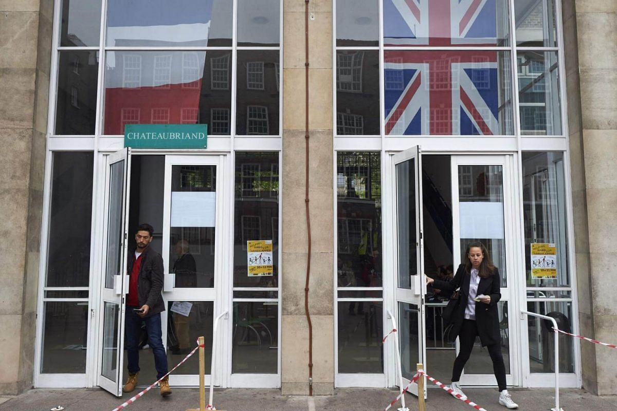 French nationals joining a queue at the Lycee Francais Charles de Gaulle in London, to cast their votes, on May 7, 2017.