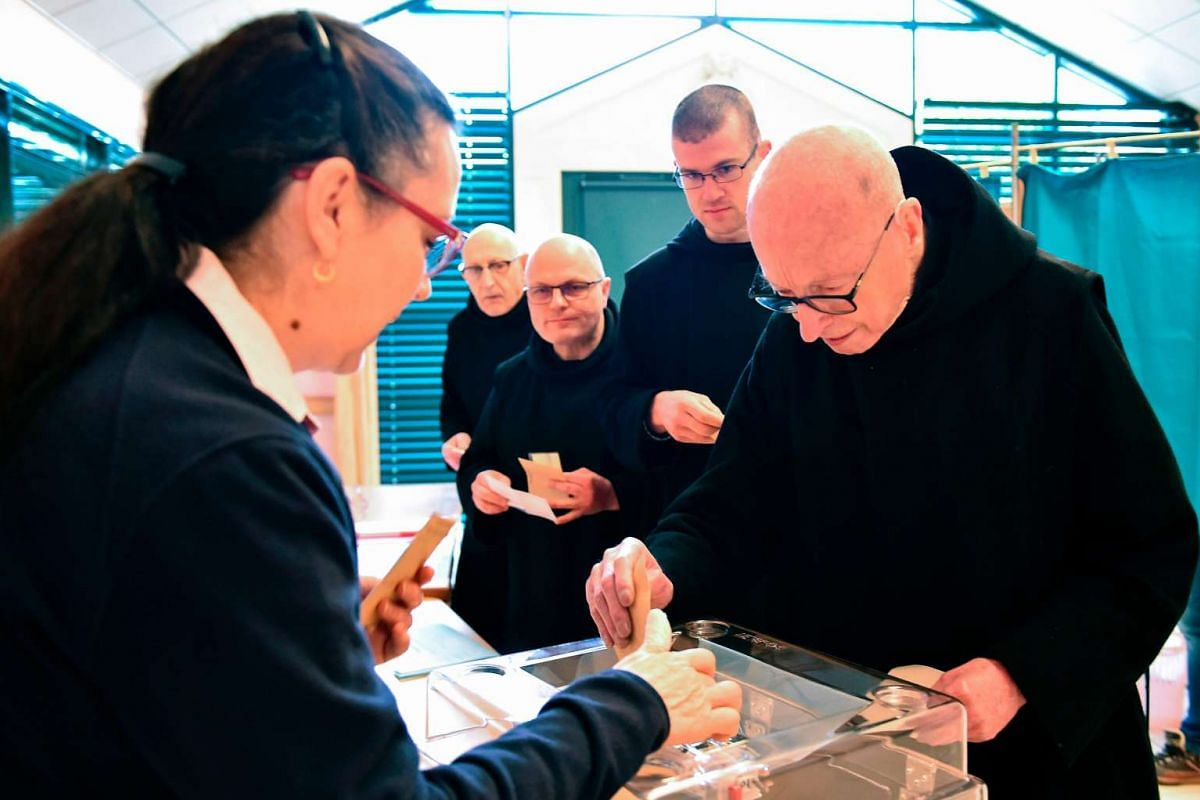 Benedictine monks from the abbey Saint Pierre de Solesmes casting their ballots in Solesmes, north-western France, on May 7, 2017.