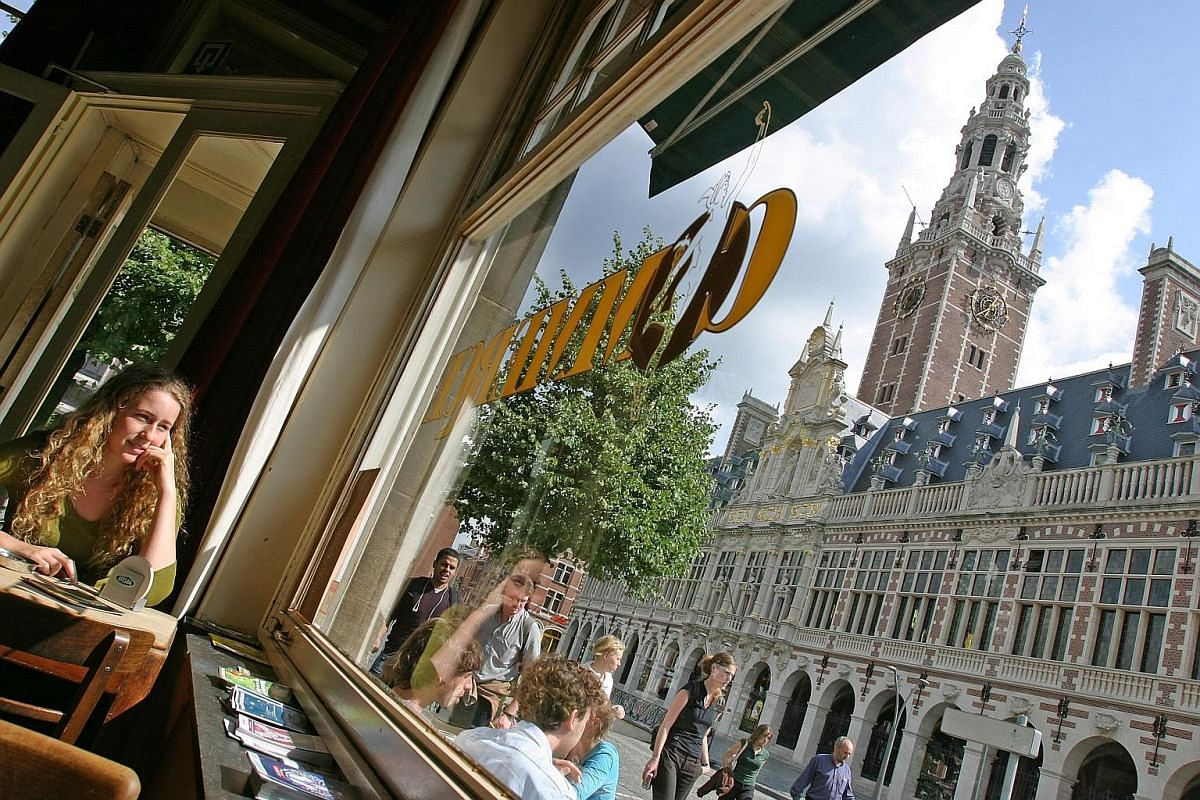 View of the University of Leuven's Central Library from a streetside cafe.
