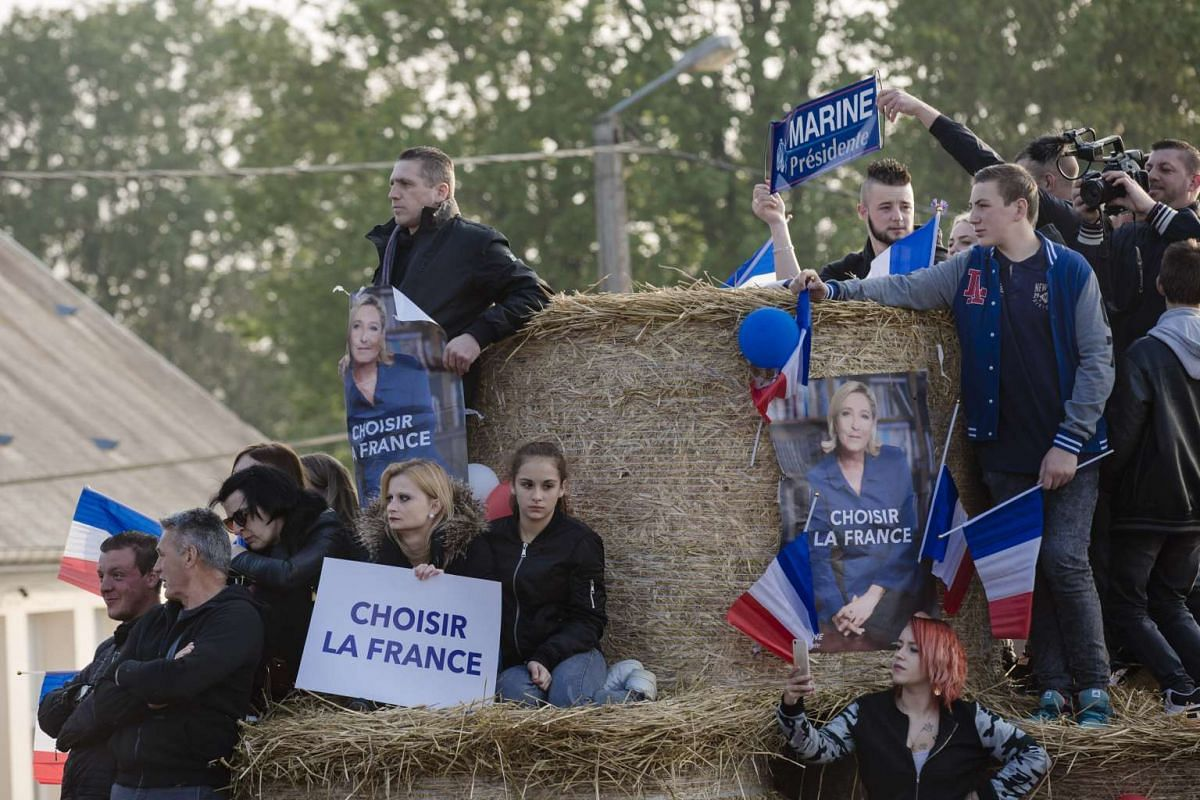 Attendees at an election campaign event for far-right candidate Marine Le Pen, in Ennemain, France, on May 4, 2017.