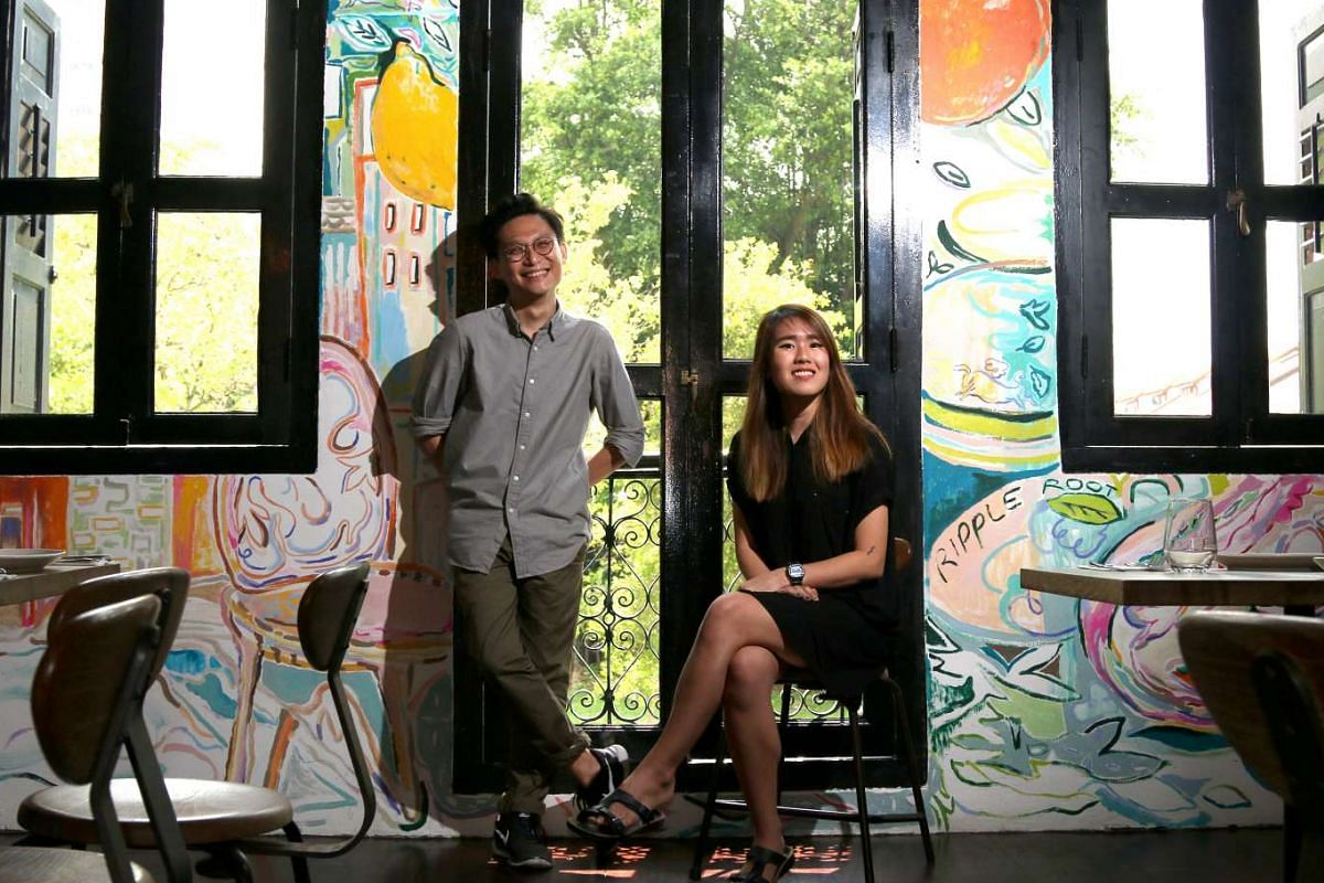 Liquan Liew and Estella Ng, who work under the moniker Ripple Root, with the mural they painted for Cicheti.