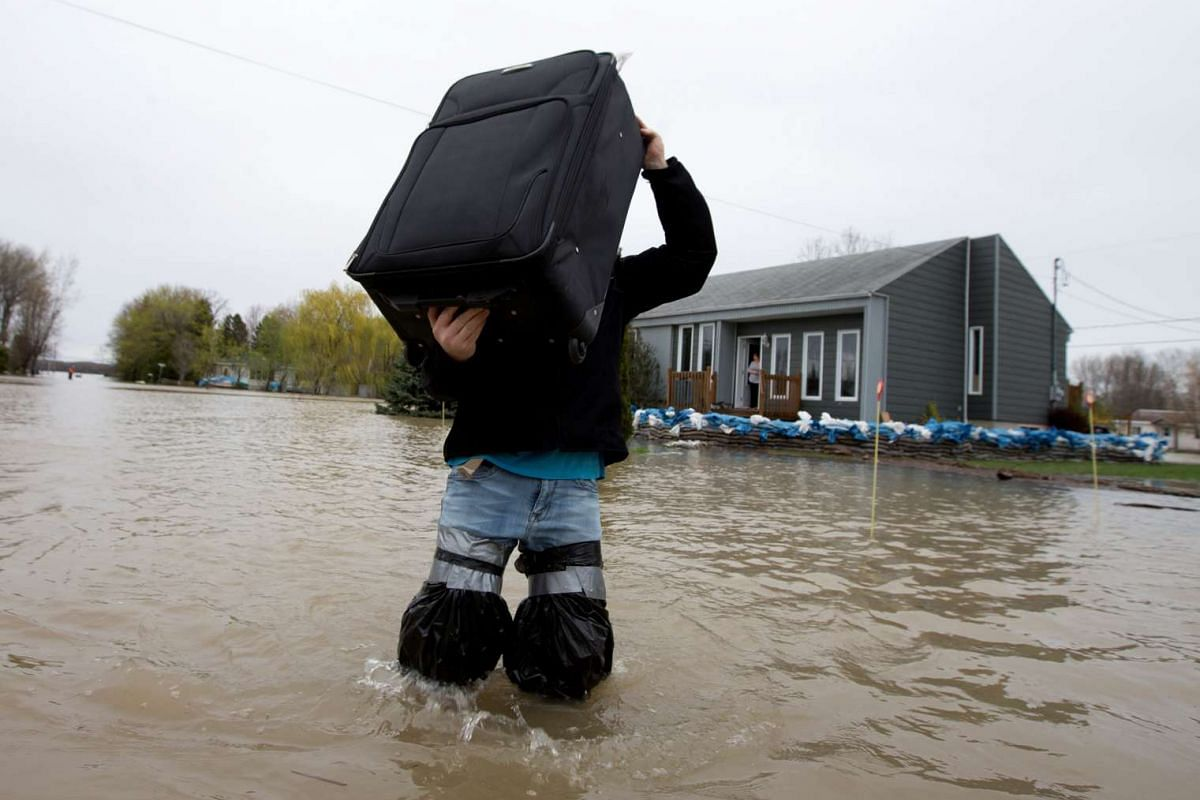 A resident removing his belongings from his home in Rigaud, Quebec, Canada.