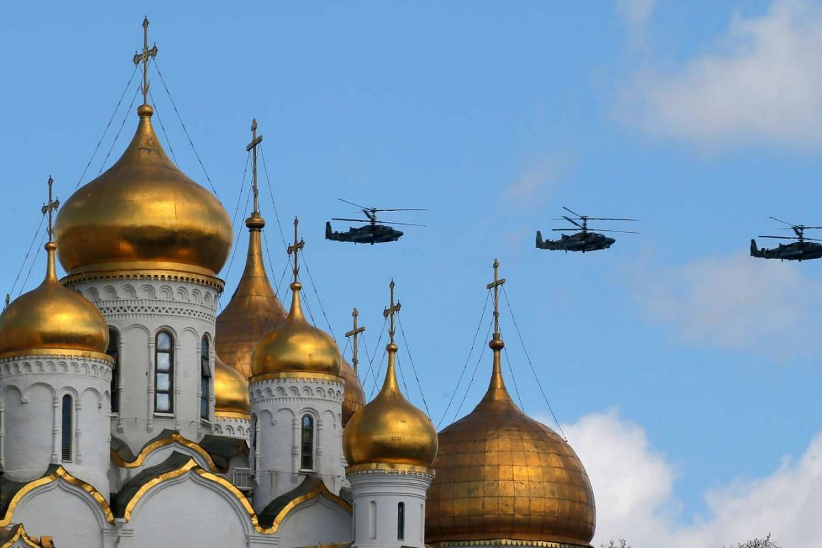 Military helicopters fly above the Kremlin churches in Moscow, Russia, May 4, 2017, during a rehearsal for the Victory Day military parade which will take place at Moscow's Red Square on May 9, 2017.