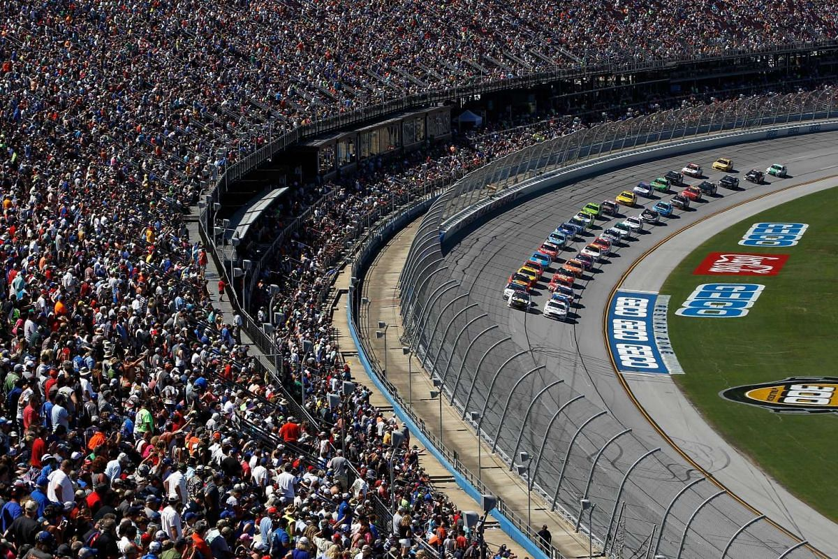 Ryan Newman, driver of the #31 Caterpillar Chevrolet, and Trevor Bayne, driver of the #6 AdvoCare Ford, lead the field in a restart during the Monster Energy NASCAR Cup Series GEICO 500 at Talladega Superspeedway on May 7, 2017 in Talladega, Alabama.