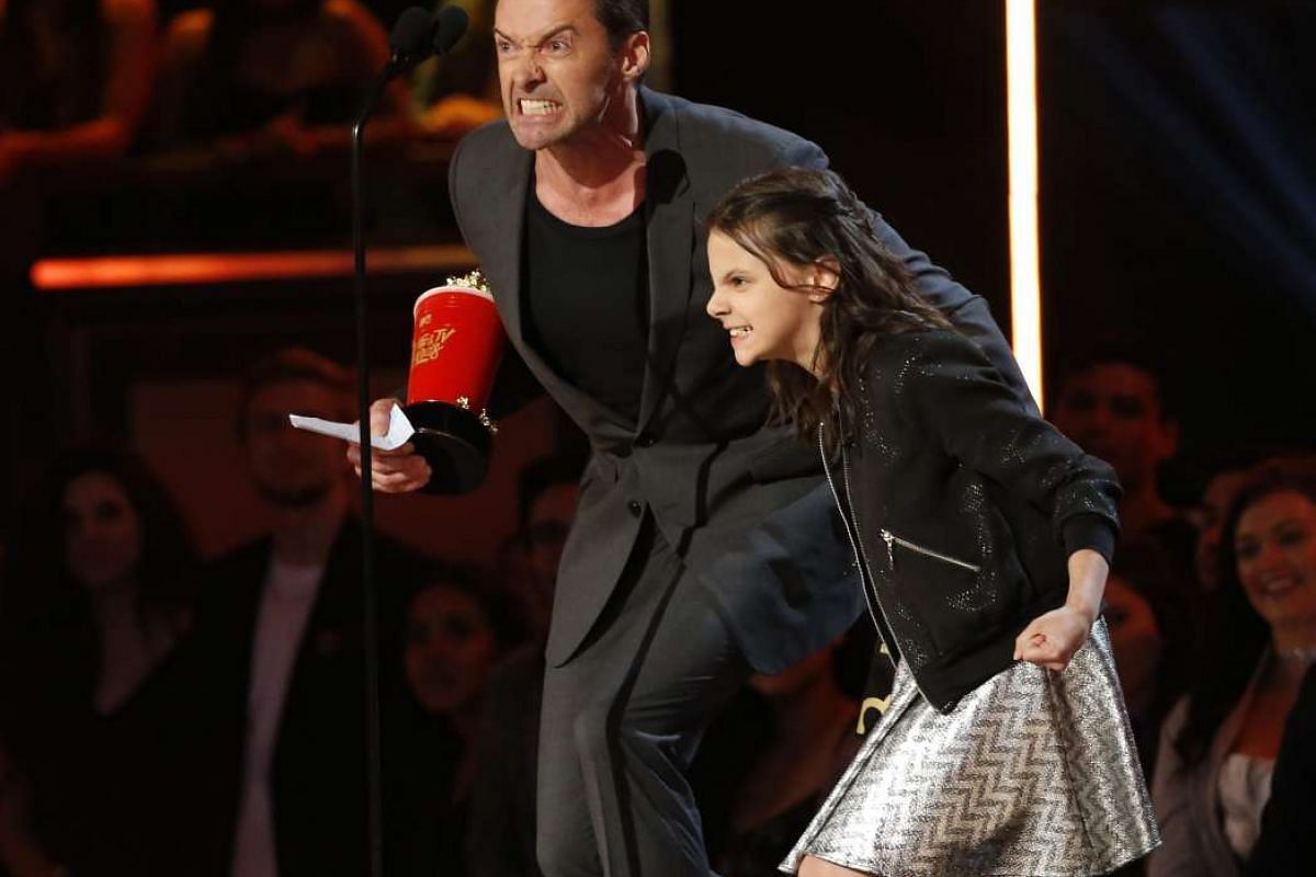 """Hugh Jackman and Dafne Keen accept the award for Best Duo for """"Logan"""" at the MTV Movie and TV Awards."""