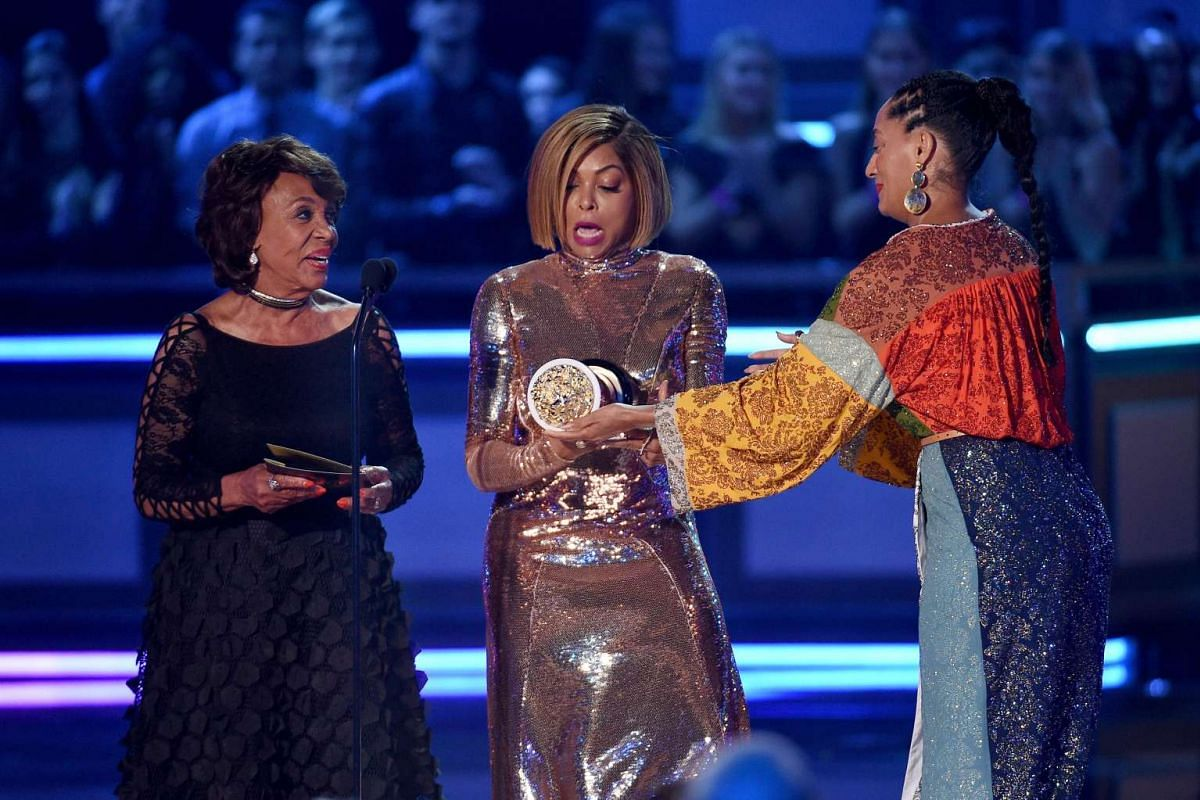Actor Taraji P. Henson (C) accepts the Best Fight Against The System award for 'Hidden Figures' from U.S. Representative Maxine Waters (L) and actor Tracee Ellis Ross (R) onstage during the 2017 MTV Movie And TV Awards at The Shrine Auditorium on May
